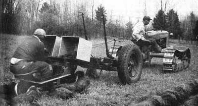 One of the newer pieces of equipment is the reforestator, which is pulled by a crawler-type tractor.