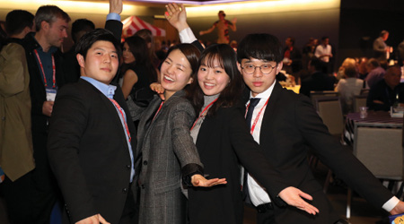 Young attendees celebrate at networking party.