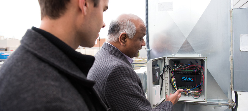 Pacific Northwest National Laboratory's Srinivas Katipamula shows how advancing building controls in equipment such as heating and cooling systems can decrease load and improve operations. (photo courtesy of PNNL)